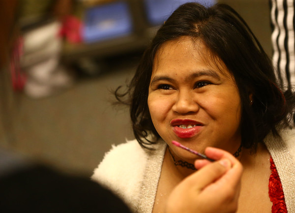 Izza West tries not to giggle as she gets lip gloss applied in the salon during Night to Shine, a  prom night experience for people with special needs at Oakbrook Church on Friday, February 9, 2018.<br /> Kelly Lafferty Gerber | Kokomo Tribune