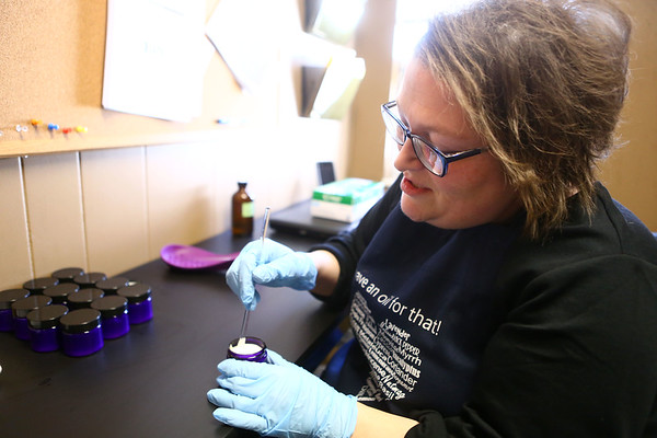 Ocean Sharp, Volunteer Coordinator at Guardian Angel Hospice and certified aromatherapist, mixes together lotion and essential oils for her Angel Relief lotion that is used on patients who have constipation.<br /> Kelly Lafferty Gerber | Kokomo Tribune
