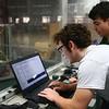 Western senior Nathanael Knight and junior Donovan Chiu work on coding their Panther Tech robot on February 20, 2018.<br /> Kelly Lafferty Gerber | Kokomo Tribune