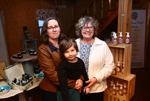 Sylvia Dunn, right, of Sylvie's Oil, along with Dunn's daughter Laura McGuire-Cone and grandson Jaxson Cone, stand inside Sylvie's Oil new location at 200 East Hoffer.<br /> Kelly Lafferty Gerber | Kokomo Tribune