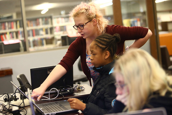 Kokomo-Howard County Public Library teen librarian Carly Wimmer helps new Girls Who Code member Oreeyah Johnson, a sixth-grader at Central Middle School, get started on February 21, 2018.<br /> Kelly Lafferty Gerber | Kokomo Tribune