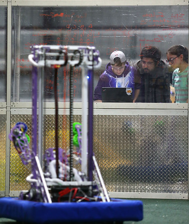 CyberTooth Robotics team out of Northwestern from left: Senior Holly Hall, mentor Rick Pease, and senior Carleigh Feldhouse practice on February 20, 2018 for an upcoming competition.<br /> Kelly Lafferty Gerber | Kokomo Tribune