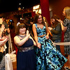 Emily Martin waves as she and her chaperone AniElise Harris walk the red carpet to cheers and applause durin Night to Shine, a prom night experience for people with special needs at Oakbrook Church on Friday, February 9, 2018.<br /> Kelly Lafferty Gerber | Kokomo Tribune