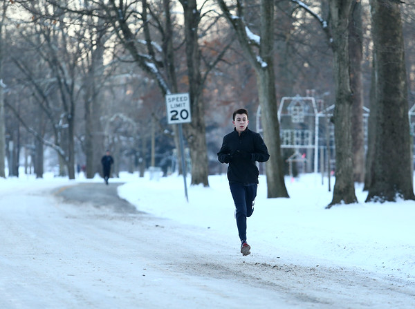 Brody Brack runs through Highland Park on a cold and snowy Wednesday, January 17, 2018.<br /> Kelly Lafferty Gerber | Kokomo Tribune