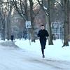 Brody Brack runs through Highland Park on a cold and snowy Wednesday, January 17, 2018.<br /> Kelly Lafferty Gerber | Kokomo Tribune