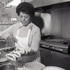 Sophia Volikas prepares coneys in Louie's Coney Island in 1989.<br /> KT file photo