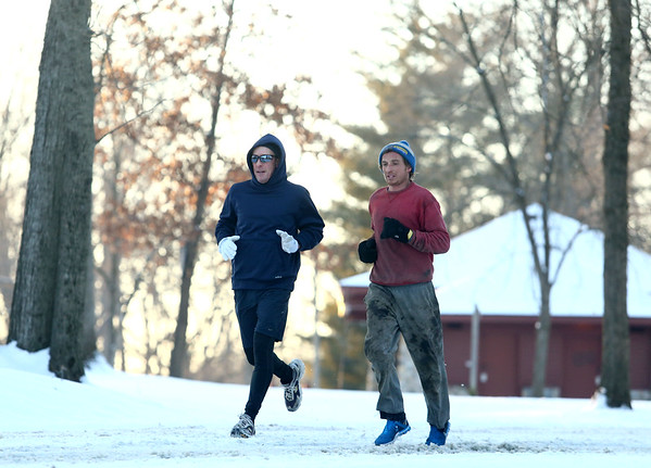 Paul Sanders, left, and Parker Jones run on a snowy trail through Highland Park on Wednesday, January 17, 2018.<br /> Kelly Lafferty Gerber | Kokomo Tribune