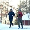 Paul Sanders, left, and Parker Jones run on a snowy trail through Highland Park on Wednesday, January 17, 2018.<br /> Kelly Lafferty Gerber | Kokomo Tribune