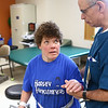 Peg Cavanaugh looks up at physical therapist Gill Moran while he helps her out of her wheelchair and gives her instructions during physical therapy at St. Vincent Kokomo on January 3, 2018. After suffering a stroke, Peg Cavanaugh is making good progress with her recovery.<br /> Kelly Lafferty Gerber | Kokomo Tribune