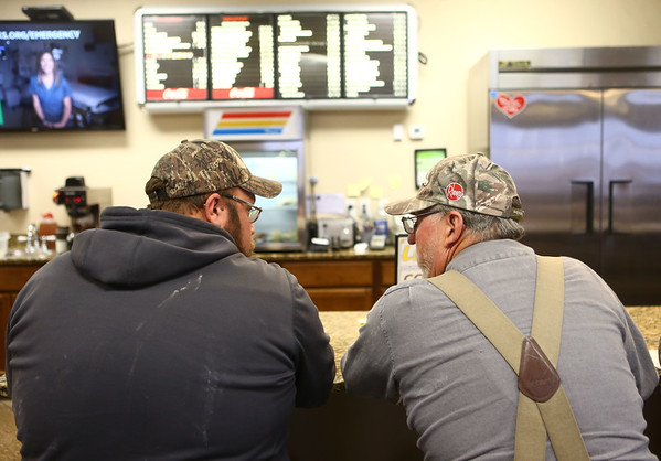 Jason Hoffeditz, left, and Don Willoughby eat lunch at chat at the counter of Louie's Coney Island on January 23, 2018.<br /> Kelly Lafferty Gerber | Kokomo Tribune