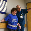 St. Vincent Kokomo physical therapist Gill Moran points to where he and Peg Cavanaugh will walk to as part of her physical therapy. After suffering a stroke several weeks ago, Peg Cavanaugh is making good progress with the recovery process.<br /> Kelly Lafferty Gerber | Kokomo Tribune