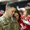 Capt. Adam Hammack bows his head in prayer during the benediction with his wife Charlotte and daughter 3-year-old Amelia during the 38th Sustainment Brigade departure ceremony on Tuesday, January 2, 2018.<br /> Kelly Lafferty Gerber | Kokomo Tribune