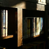 Afternoon light filters in through the windows onto some of the original 100-year-old shelving at Converse Public Library on January 18, 2018.<br /> Kelly Lafferty Gerber | Kokomo Tribune