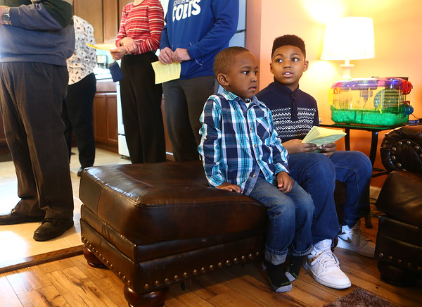 Brothers Josiah Reeves, 4, and Corahn Browner listen as their new home is blessed during Kokomo's Habitat for Humanity's house blessing and dedication of Theresa Everett's new home on Belvedere Drive on Sunday, January 28, 2018.<br /> Kelly Lafferty Gerber | Kokomo Tribune