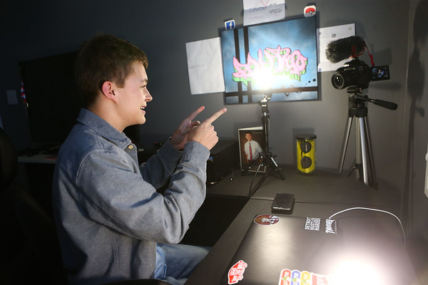 Payton Irwin films a greeting for a video on his YouTube channel at the desk in his bedroom in Kokomo on January 26, 2018.<br /> Kelly Lafferty Gerber | Kokomo Tribune