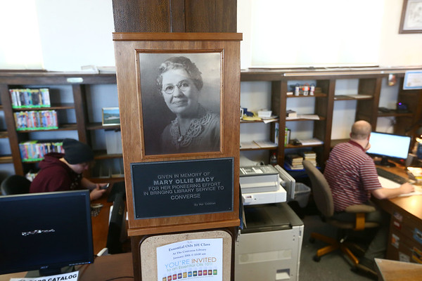 A plaque is on display at the Converse Public Library honoring Mary Macy who brought a library to Converse 100 years ago.<br /> Kelly Lafferty Gerber | Kokomo Tribune