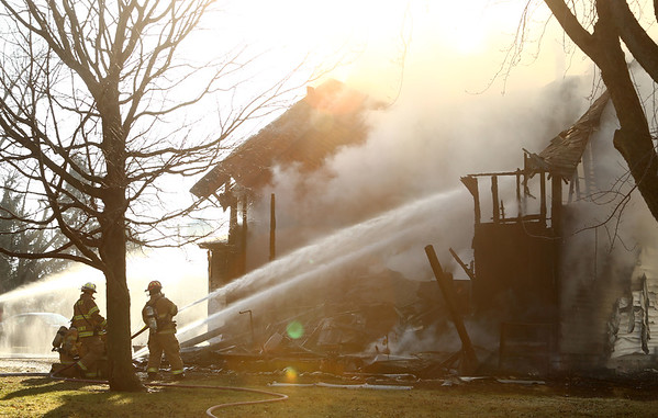 Firefighters respond to a house fire at 500 N. Independence in Windfall on Thursday at 3:25 p.m. after reports of flames shooting out of the second story roof. Residents were awakened by smoke, but made it outside safely and no one was injured.<br /> Kelly Lafferty Gerber | Kokomo Tribune