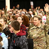 Maj. Jennifer McGhee raises her hand after a speaker asks those who are deploying with 38th Sustainment Brigade to raise their hands during the departure ceremony on Tuesday, January 2, 2018.<br /> Kelly Lafferty Gerber | Kokomo Tribune