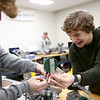 Eastern High School sophomores Jaxon Brantley, left, and Ricky Sample-Ward joke around as they make adjustments to their robot during a Comet Tech club meeting on January 10, 2018.<br /> Kelly Lafferty Gerber | Kokomo Tribune