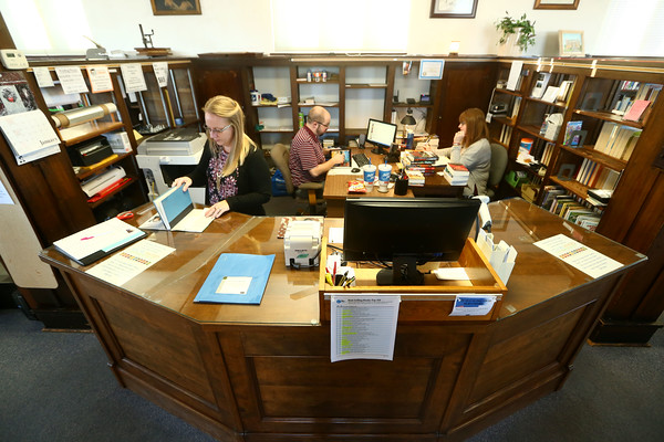 Christina Drollinger works at the original 100-year-old circulation desk at the Converse Public Library on January 18, 2018.<br /> Kelly Lafferty Gerber | Kokomo Tribune