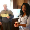 Theresa Everett holds a candle as her kitchen is blessed during Kokomo's Habitat for Humanity's  house blessing and dedication of Theresa Everett's new home on Belvedere Drive on Sunday, January 28, 2018.<br /> Kelly Lafferty Gerber | Kokomo Tribune