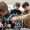 From left: Eastern High School sophomores and Comet Tech members Braxton Caldwell, Hobee Hembree, and Gavin Vandeventer make adjustments to their robot as they prepare for an upcoming competition.<br /> Kelly Lafferty Gerber | Kokomo Tribune