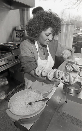 Toula Volikas-Linville prepares coneys at Louie's Coney Island in 1992.<br /> KT file photo