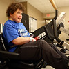 Peg Cavanaugh grins as she pedals on the bike during physical therapy at St. Vincent Kokomo on Wednesday morning, January 3, 2018. After suffering a stroke earlier in December, Cavanaugh is in good spirits and is making good progress with her recovery.<br /> Kelly Lafferty Gerber | Kokomo Tribune