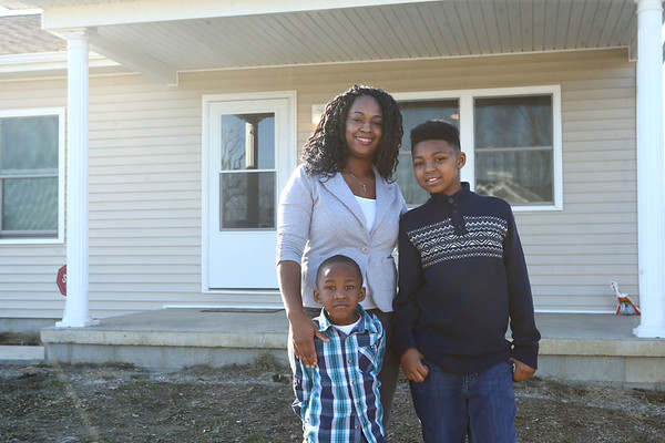 Theresa Everett and her sons Josiah Reeves, 4, and Corahn Browner, 10, had their new home blessed during a dedication ceremony by Kokomo's Habitat for Humanity on Sunday, January 28, 2018.<br /> Kelly Lafferty Gerber | Kokomo Tribune