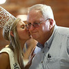 Howard County 2018 Fair Queen Reagan Ritchie gives Stan Rush a kiss during the fair queen kiss auction at the Howard County 4-H Fair on Thursday, July 12, 2018.<br /> Kelly Lafferty Gerber | Kokomo Tribune