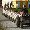 Bob's Bumpy Barrels go for a ride through Pioneer Village during the Howard County Fair on Thursday, July 12, 2018.<br /> Kelly Lafferty Gerber | Kokomo Tribune