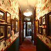 The upstairs hallway with photos of Starr's ancestors. The George Tate house, shown here on July 17, 2018, located at 114 East Jefferson Street and now owned by Dorwin Starr, was recently placed on the National Register of Historic Places. <br /> Kelly Lafferty Gerber | Kokomo Tribune