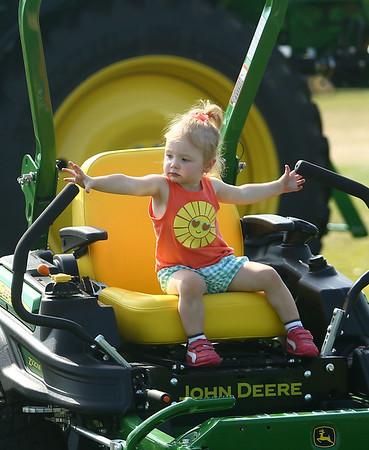 Addyson Peperak, 2, checks out some of the farm equipment during the Howard County Fair on Thursday, July 12, 2018.<br /> Kelly Lafferty Gerber | Kokomo Tribune