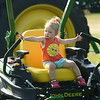 Addyson Peperak, 2, checks out some of the farm equipment during the Howard County Fair on Thursday, July 12, 2018.<br /> Kelly Lafferty Gerber | Kokomo Tribune