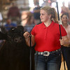 Megan Hawkins shows a cow during the Supreme Showman competition at the Howard County 4-H Fair on Wednesday, July 11, 2018. Hawkins was named Supreme Showman.<br /> Kelly Lafferty Gerber | Kokomo Tribune