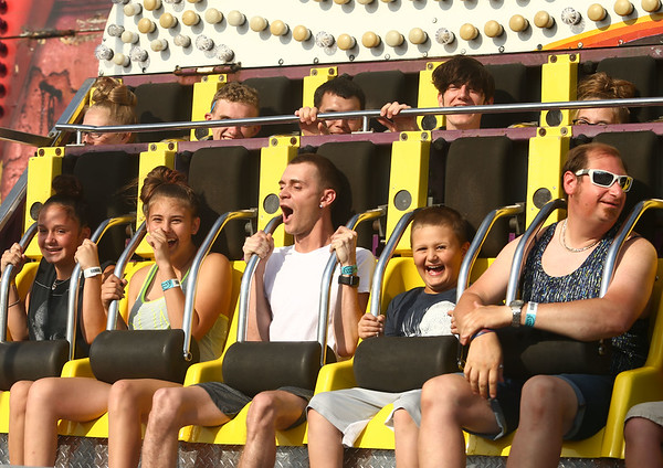 Kids and adults enjoy the rides at the Howard County Fair on Thursday, July 12, 2018.<br /> Kelly Lafferty Gerber | Kokomo Tribune