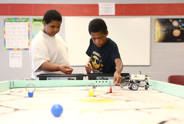 Charles Brown, 11, left, and M.J. McColl, 11, work together on their robot during the Carver Center robotics team practice on Tuesday, July 3, 2018.<br /> Kelly Lafferty Gerber | Kokomo Tribune
