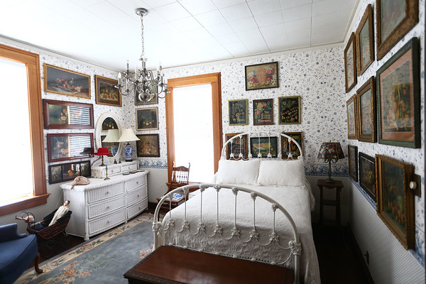An upstairs bathroom with still life art on the walls from the 1878 period. The George Tate house, shown here on July 17, 2018, located at 114 East Jefferson Street and now owned by Dorwin Starr, was recently placed on the National Register of Historic Places. <br /> Kelly Lafferty Gerber | Kokomo Tribune