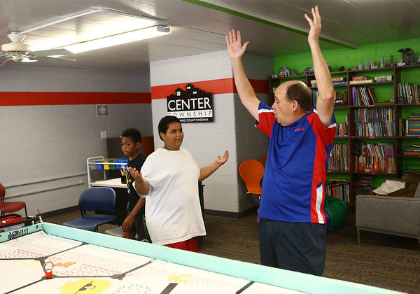 """11-year-old Charles Brown and Carver Center robotics team mentor Jim McCarter throw their arms up and say, """"goal!"""" after Brown's robot pushes the soccer ball into the net during robotics practice on Tuesday, July 3, 2018.<br /> Kelly Lafferty Gerber 