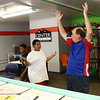 "11-year-old Charles Brown and Carver Center robotics team mentor Jim McCarter throw their arms up and say, ""goal!"" after Brown's robot pushes the soccer ball into the net during robotics practice on Tuesday, July 3, 2018.<br /> Kelly Lafferty Gerber 