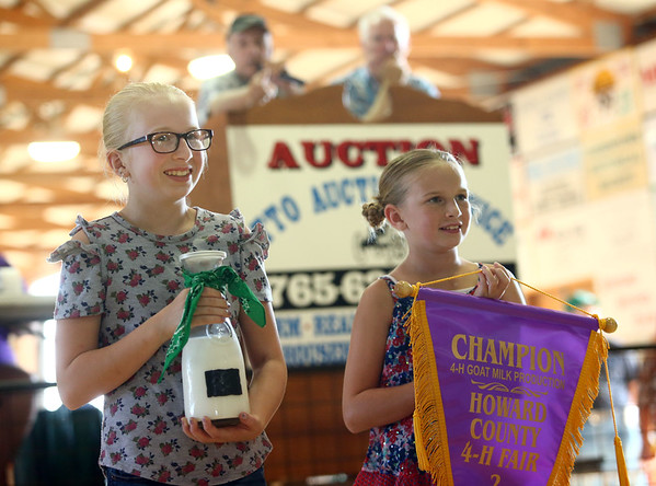 Addison Sparling auctions off her champion goat milk during the Livestock Auction at the Howard County 4-H Fair on Thursday, July 12, 2018.<br /> Kelly Lafferty Gerber | Kokomo Tribune
