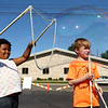 Cody Word, 7, right, watches as 5-year-old Violet Matthews creates a big bubble outside the Kokomo-Howard County Public Library on Friday, July 6, 2018.<br /> Kelly Lafferty Gerber | Kokomo Tribune