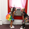 Kiddie clowns Chloe Galbraith, left, and Rosalynn Roush, feel the air conditioning as the play in front of the window unit in the clown area before the start of the Peru Amateur Circus on Saturday, July 14, 2018.<br /> Kelly Lafferty Gerber | Kokomo Tribune