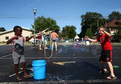 Kids and adults enjoy the bubble truck at the Kokomo-Howard County Public Library on Friday, July 6, 2018. Kelly Lafferty Gerber | Kokomo Tribune