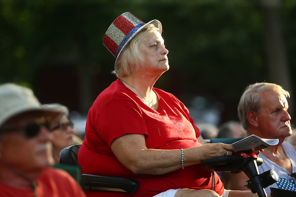 """Vickie Dunn listens to the patriotic music during Kokomo Park Band's """"Let Freedom Ring"""" concert in Highland Park on July 4, 2018.<br /> Kelly Lafferty Gerber 