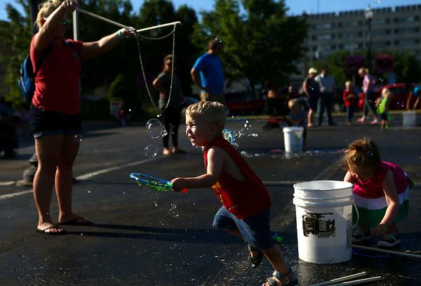 Waelyn Burkett, 2, enjoys the bubbles at the bubble truck parked outside the Kokomo-Howard County Public Library on Friday, July 6, 2018.<br /> Kelly Lafferty Gerber | Kokomo Tribune
