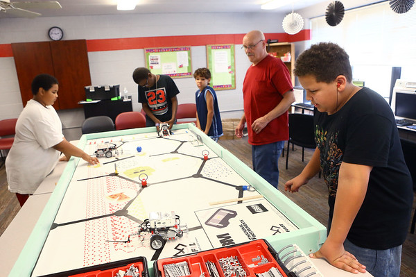 Angelis Rogers, 11, right, along with other members of the Carver Center robotics team practice on Tuesday, July 3, 2018.<br /> Kelly Lafferty Gerber | Kokomo Tribune