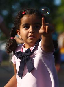 Rokaia Moawad, 4, chases down a bubble to pop it near the bubble truck at the Kokomo-Howard County Public Library on Friday, July 6, 2018. Kelly Lafferty Gerber | Kokomo Tribune