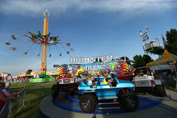 Kids ride along in a monster truck ride during the Howard County Fair on Thursday, July 12, 2018.<br /> Kelly Lafferty Gerber | Kokomo Tribune