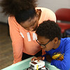 Adreyana Jones, 11, and her brother Jeremiah Jones, 9, test out their robot during the Carver Center robotics team practice on Tuesday, July 3, 2018.<br /> Kelly Lafferty Gerber | Kokomo Tribune